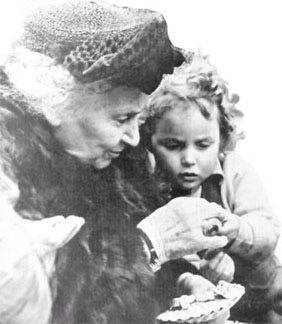 photograph of Dr. Montessori and a child